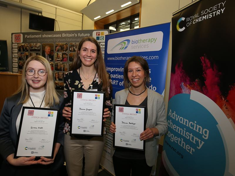 STEM for Britain winners Dr Gemma Smith, Florence Gregson and Fabienne Bachtiger hold their certificates and smile at the camera