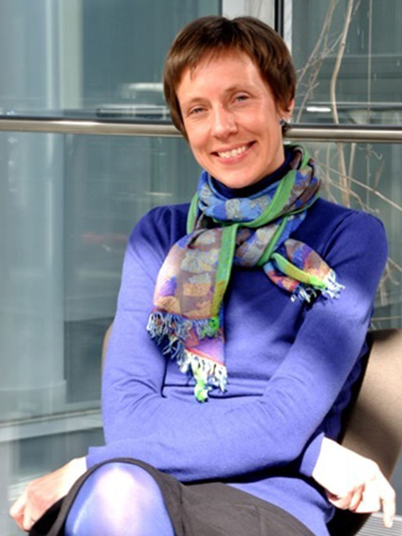 Sabine Szunerits in purple jumper and scarf, from waist up