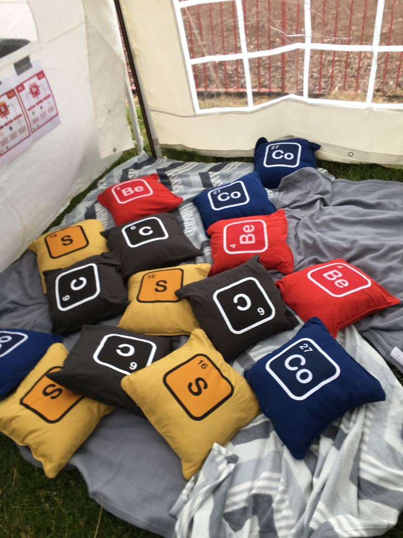 The 'chill out' area at the festival, containing coloured cushions with element symbols on them.