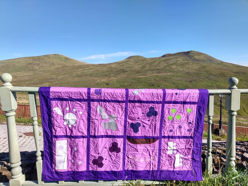 patchworth fabric quilt over a fence in Stratclyde hills