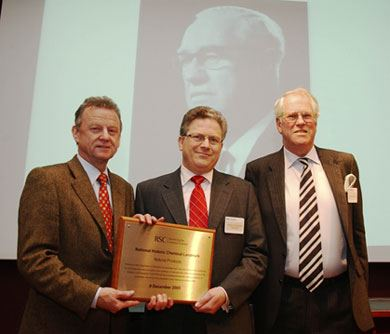 (From left to right) President Dr Simon Campbell, Professor Jeremy Sanders, Sandy Todd, son of Lord Todd (pictured in the backdrop)