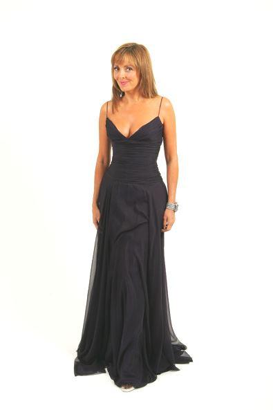 Carol Vorderman wearing a modern dress