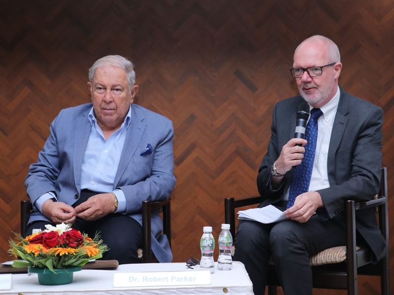 Image of Yusuf Hamied and Robert Parker seated at a press conference © Royal Society of Chemistry