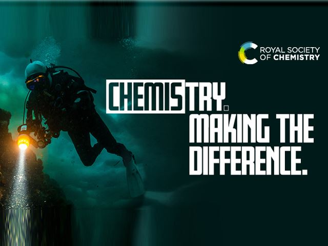 "The words ""Chemistry. Making the Difference"" against a background of an underwater scene showing a scuba diver shining a torch on some rocks"