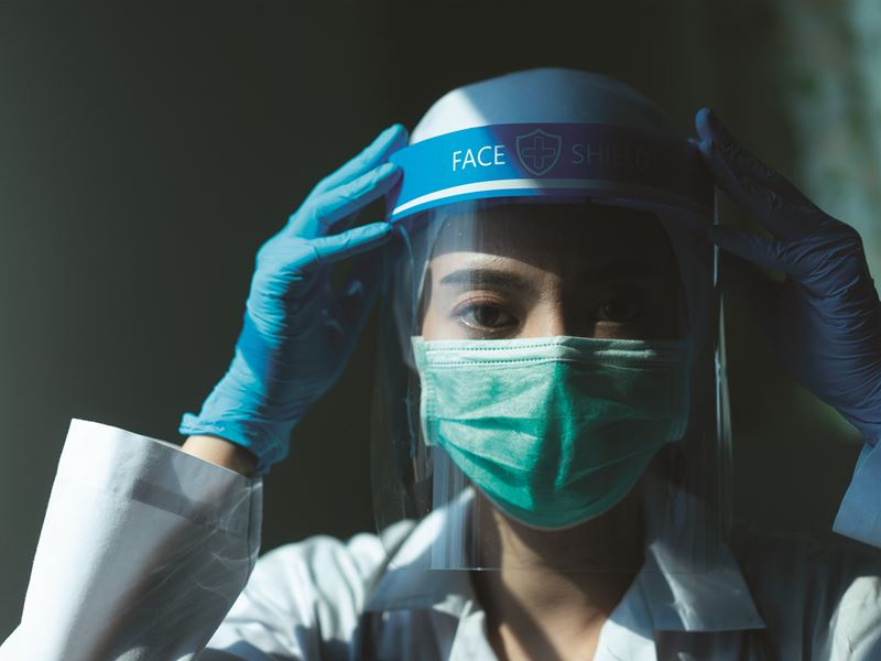 Image of a woman wearing a protective mask