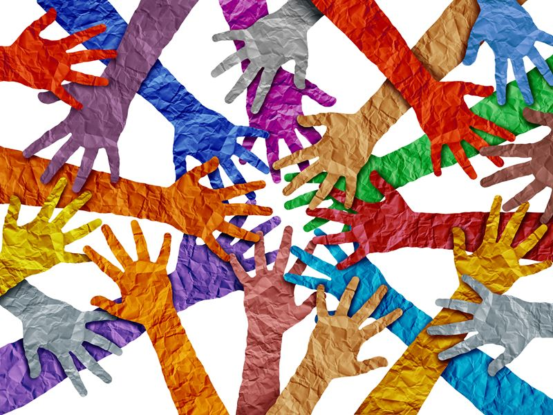 Overlapping paper hands in various colours