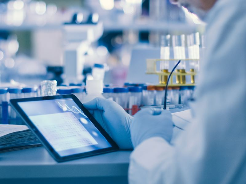Researcher in a lab using a tablet
