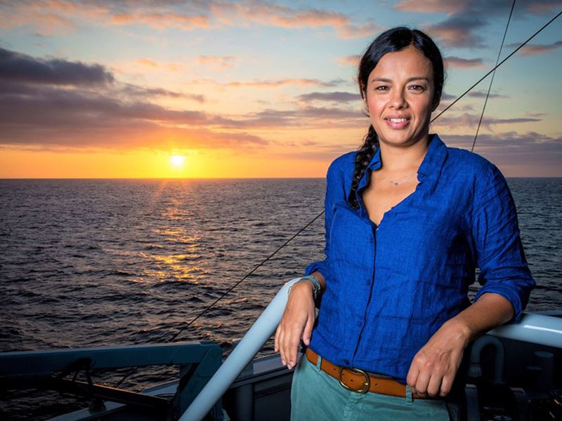 Liz Bonnin poses on a boat in front of the sunset