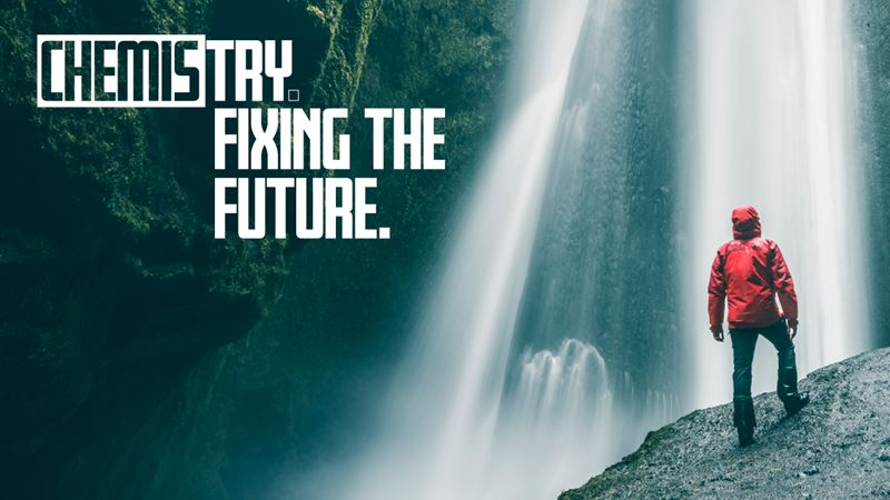 chemistry fixing the future branding - man at bottom of waterfall on a rock
