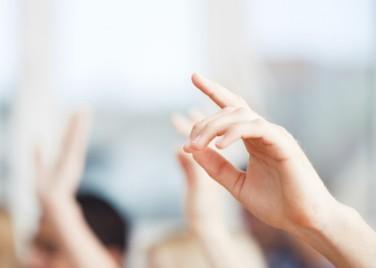 people raising hands in crowd.jpg
